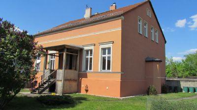 Gartenseite mit Veranda