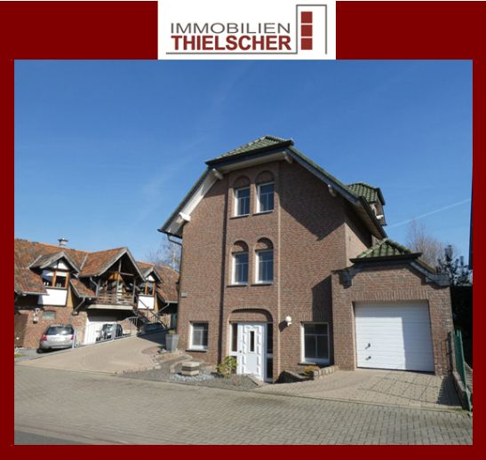 Exklusives Einfamilienhaus mit zwei Garagen und Einliegerwohnung