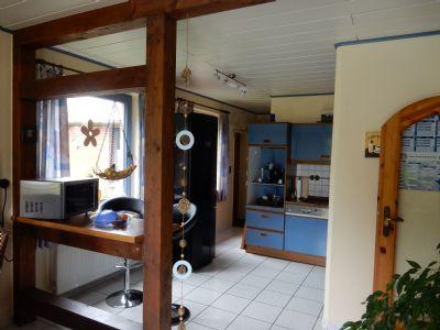Gemütliche Wohnküche mit Holzbalken