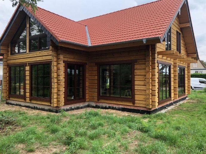 Ihr Projekt - Holzhaus zum Ausbau im kanadischen Stil auf schön geschnittenem Grundstück