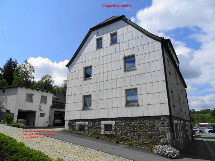 Doppelhaushälfte mit 2 Wohnungen und Nebengebäude