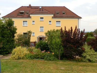 Rückansicht Haus mit Mietergarten