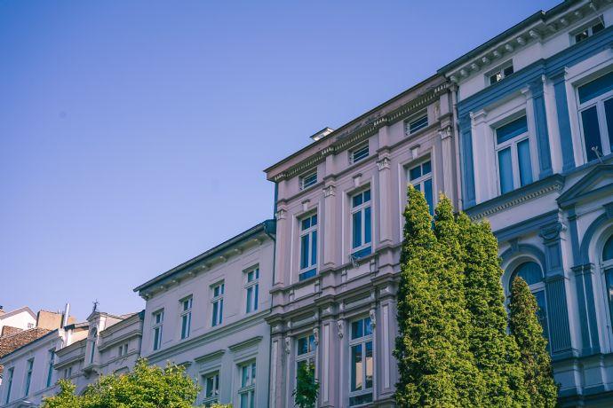 Mehrfamilienhaus mit 16 Wohn- & 2 Gewerbeeinheiten
