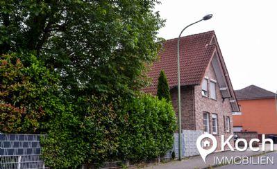 Suchen Sie ein freistehendes Einfamilienhaus im Zentrum mit Gewerbeanteil?