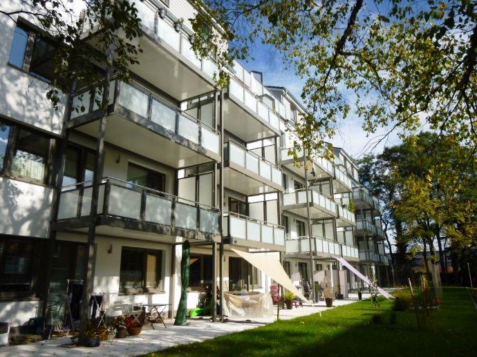 2,5 Zi Wohnung mit großer Südterrasse und Gartenanteil