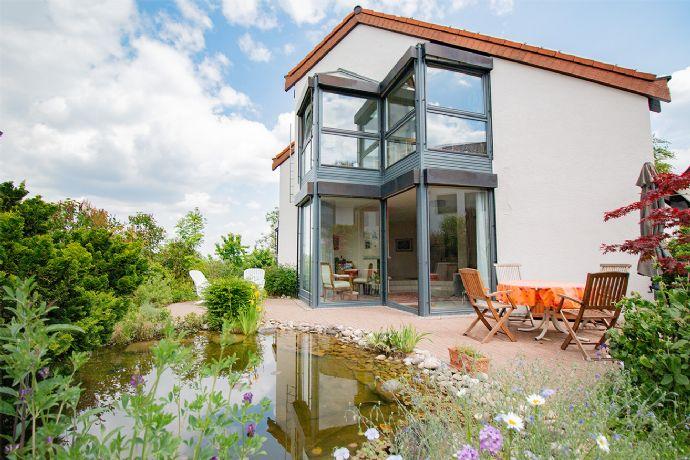 Großartiges Einfamilienhaus mit Einliegerwohnung und wunderbarem Garten in schöner Wohnlage