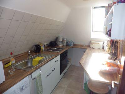 Eine Küche im Dachgeschoß