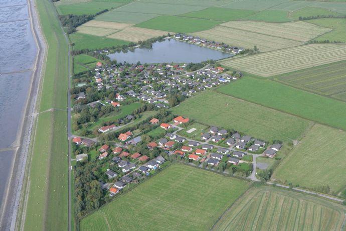Gepflegtes Ferienhaus in Sackgasse im gewachsenen Feriendorf, unmittelbar an der Nordsee