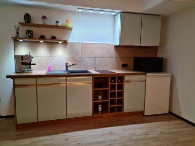 1-Zimmer-Wohnung mit 50 m² Wfl. Souterrain