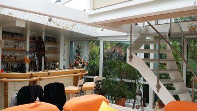 Wintergarten mit Bar und Empore