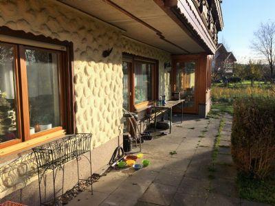 großteils überdachte Terrasse und Wintergarten