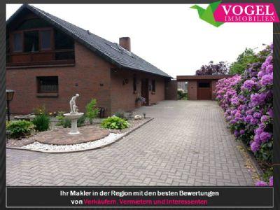 ***Traum-Einfamilienhaus mit TOP-Einbauküche, Doppelgarage und schönem Garten***   Vogel Immobilien