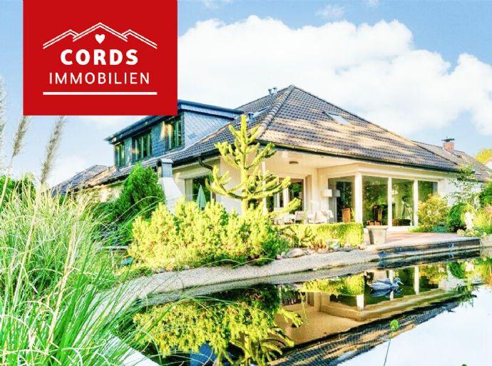 Modernisierte Luxusvilla mit gut vermieteter Einliegerwohnung in Waldrandlage!