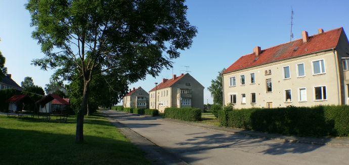 Vier Mehrfamilienhäuser (jeweils ca. 340 m²) und ein Nebengebäude auf 6500 m² Grund