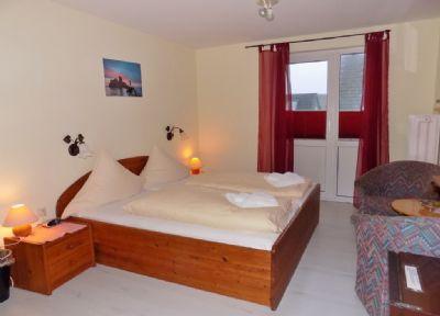Pension/Ferienhaus Haus Ahrens - Doppelzimmer Lumme - Balkon mit tlw. Meerblick - 1 Stern nach DTV