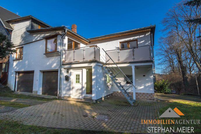Klein und fein: Solides Einfamilienhaus in idyllischer Lage | EBK | 2 Garagen | Stellplätze!