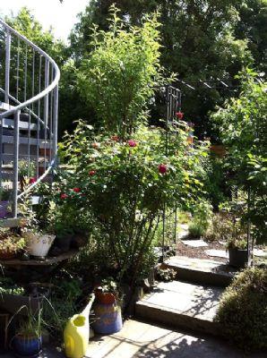 Kleine Ferienwohnung mit bezauberndem Garten, Stadtrand