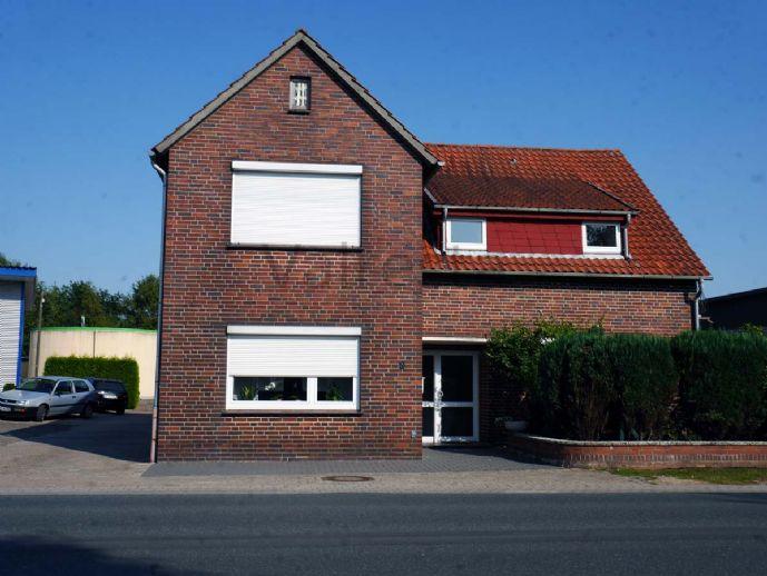 Gepflegtes Zweifamilienhaus in Neuenkirchen mit Werkstatthalle
