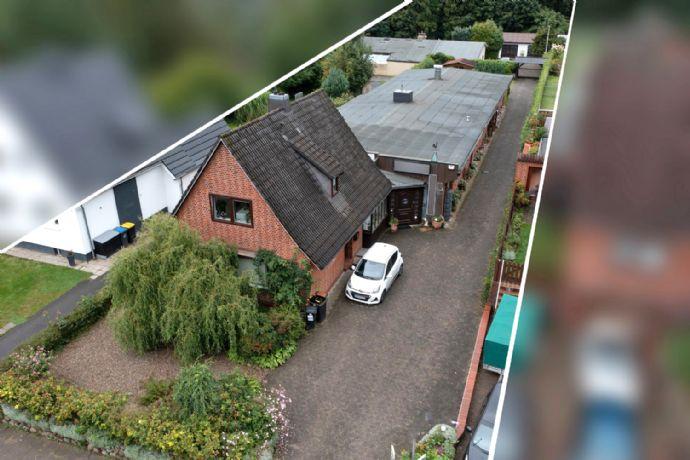 Vermietetes Einfamilienhaus und Wohn- Geschäftshaus