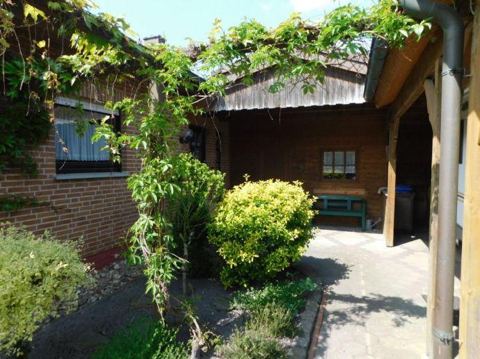 ***BÜSCHER IMMOBILIEN*** Schönes und gepflegtes Einfamilienhaus mit Wintergarten Carport, jetzt in Ochtrup zu verkaufen