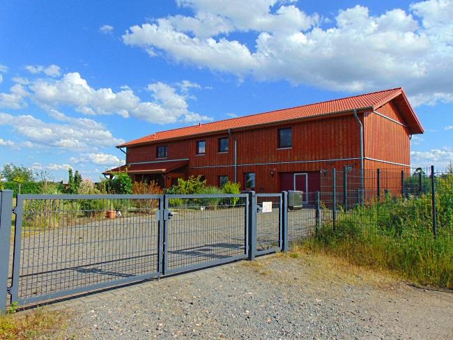Neuwertiges Skandinavisches Niedrigenergie-Holzhaus mit Blockbohlen-Fassade! Vielseitig nutzbare Wohn-und Gewerbeimmobilie mit hochwertigen Features!