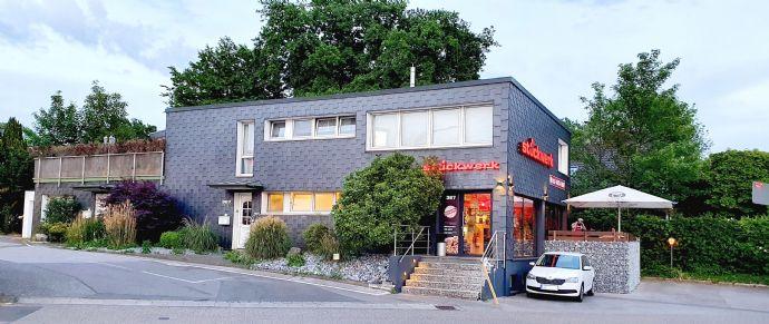 Wohn- und Geschäftshaus mit top platzierter Systemgastronomie in markanter Lage auf den Südhöhen von Wuppertal