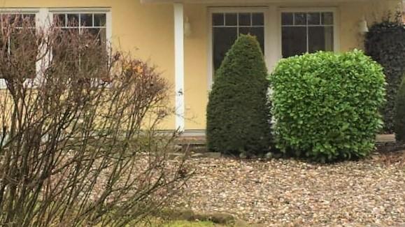 Ansprechende Eigentumswohnung mit Terrassen, Garten u. Garage