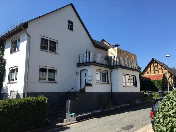 Kapitalanlage Gepflegte 3 Zimmer Doppelhaushälfte, mit Balkon und großer Garage in einem OT von Haiger zu verkaufen Jährliche Rendite von ca. 5,5%