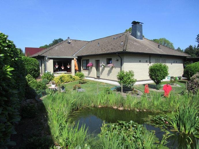 Nordleda Einfamilienhausbungalow mit Carport & Whirlpool sowie Baugrundstück