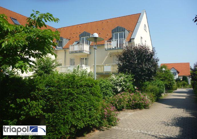 Hübsche Maisonettewohnung mit Laminatboden und Balkon in ruhiger und grüner Lage.