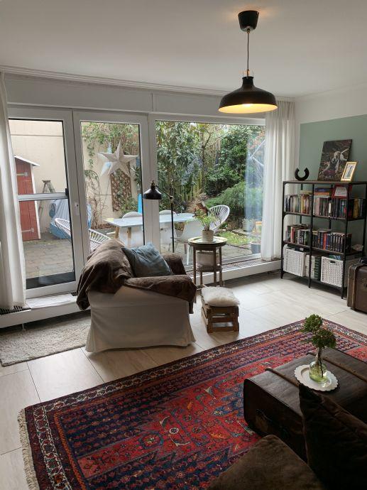 Außergewöhnliche Splitlevel Terrassenwohnung - 3,5-Zimmer inkl. neuer EBK- mit Terrasse und Garten