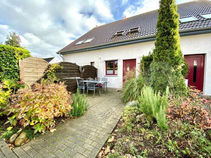 Travemünde - Reihenmittelhaus mit kleinem Garten und Carport in beliebter Wohnlage