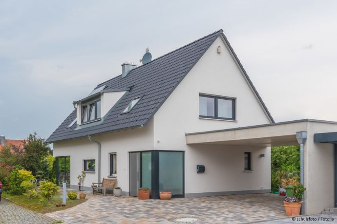 Schnuckeliges Einfamilienhaus mit hübschem Garten und ELW