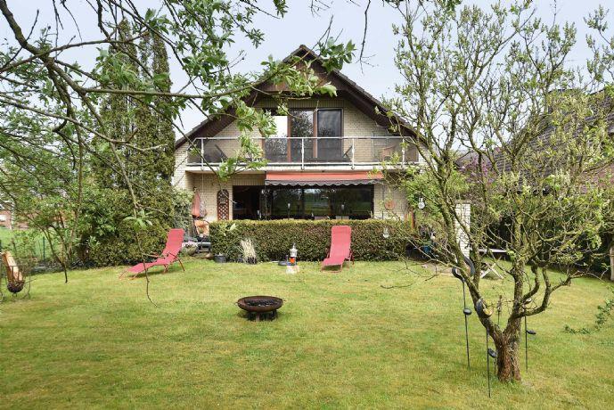 Mühlenrade - Gut vermietetes Zweifamilienhaus in Feldrandlage