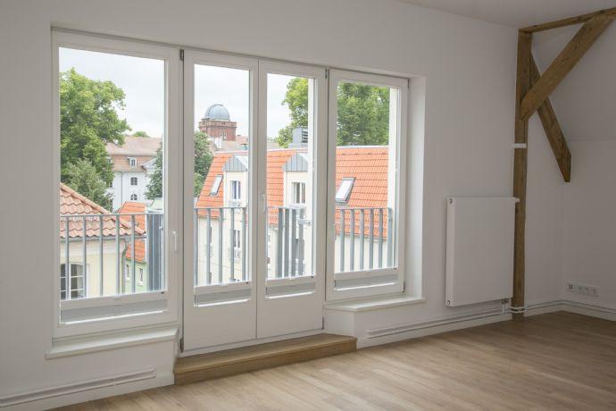 Perfekt ausgebaute 3- Zimmer Dachgeschosswohnung mit Balkon im Zentrum