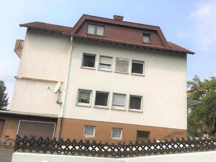 Großes Grundstück mit Baupotenzial und großflächigem Mehrfamilienhaus