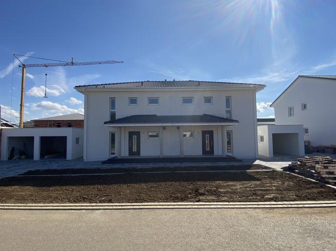 Erstbezug Zwei moderne Doppelhaushälften zu